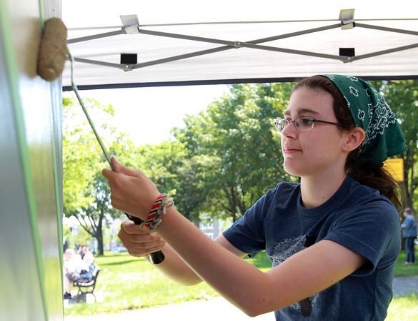 Salem: Clare AuBuchon, of Salem, paints an electrical box at Lafayette Park on Wednesday afternoon. David Le/Salem News