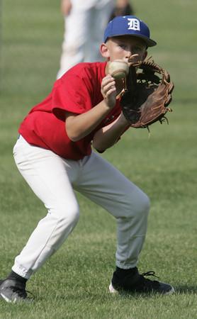Danvers:<br /> Kevin Pohle at the Danvers American Little League practice at Memorial Field.<br /> Photo by Ken Yuszkus / Salem News, Monday, June 24, 2013.