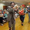 Peabody:<br /> From left, Russell Correia, Zack Sylvia, Jake Vieira, and Mike Monte are 4 of the 5 members of the Hills-Mills Clowns marching and playing instruments during the Brooksby Village 4th of July parade held indoors at the McIntosh Clubhouse.<br /> Photo by Ken Yuszkus / Salem News, Friday, June 28, 2013.