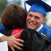 Danvers: Danvers High School graduate Joe Manson gives Principal Susan Ambrozavitch a big hug upon receiving his diploma on Saturday afternoon. David Le/Salem News