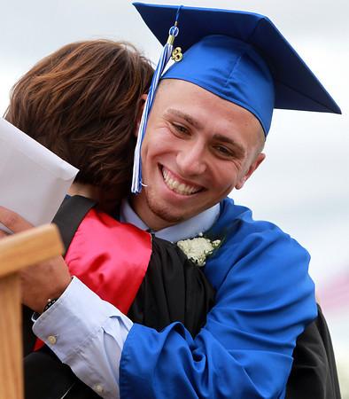 Danvers: Danvers High School graduate Joe Strangie hugs Danvers Principal Susan Ambrozavitch after receiving his diploma on Saturday afternoon. David Le/Salem News
