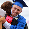 Danvers: Danvers High School graduate Joe Strangie hugs Danvers Principal Susan Ambrozavitch after receiving his diploma on Saturday afternoon. David Le/Salem News