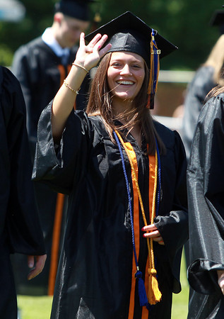 Beverly: Beverly High School graduate Rebecca Kemmer waves to her family as she marches into Graduation on Sunday afternoon. David Le/Salem News