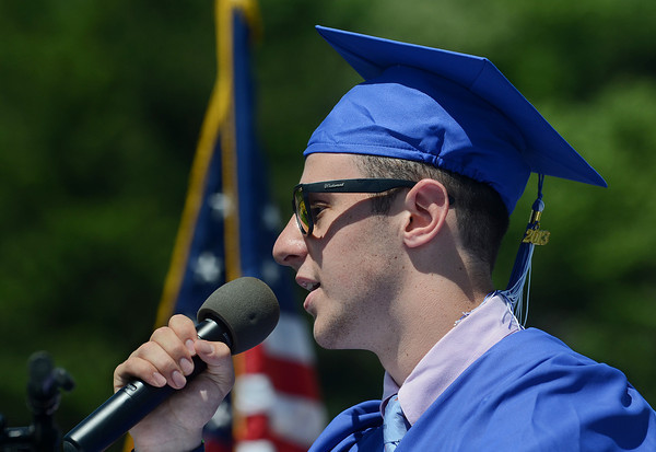 Graduating Senior Scott Powell, the elected class speaker, addresses his classmates Sunday during Swampscott High School's 2013 graduation ceremonies at the Blocksidge Field House in Swampscott. (Photo by Mike Springer)
