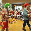 Peabody:<br /> From left, Matt Alves, Mike Monte, and Zack Sylvia are 3 of the 5 members of the Hills-Mills Clowns marching and playing instruments during the Brooksby Village 4th of July parade held indoors at the McIntosh Clubhouse.<br /> Photo by Ken Yuszkus / Salem News, Friday, June 28, 2013.