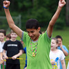 Beverly: North Beverly Elementary School 5th grader Brandon Rodriguez pumps his fists in the air in celebration after scoring a point against the teachers in the 5th graders vs faculty volleyball game on Field Day on Thursday. David Le/Salem News