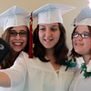 Salem: From left, Salem Academy Charter School graduates Kate Schoelles, Cara Marchand, and Erica Turlo take a photo of themselves prior to the start of graduation on Friday afternoon. David Le/Salem News