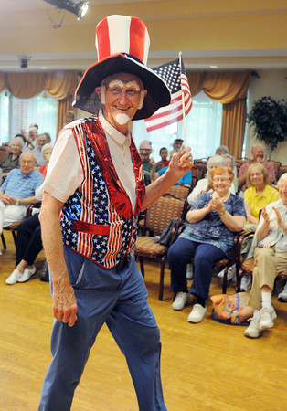 Peabody:<br /> Don Bade parades as Uncle Sam during the Brooksby Village 4th of July parade held indoors at the McIntosh Clubhouse.<br /> Photo by Ken Yuszkus / Salem News, Friday, June 28, 2013.