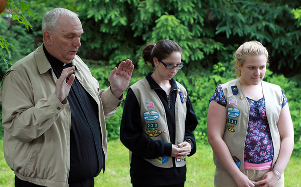 Beverly: Father Jack Gentleman, of the Sacred Heart Parish in Manchester, blesses a meditation garden, constructed by Girls Scouts Kira Kennedy, 15, of Beverly, center, and Leah Fortin, 14, of Salem, on Monday afternoon. David Le/Salem News