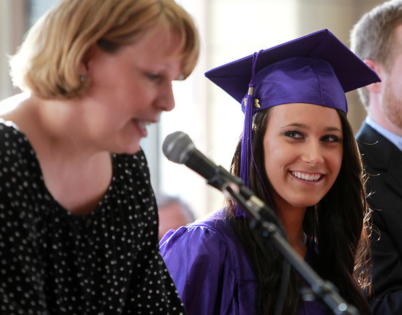 Beverly: Northshore Recovery High School graduate Cynthia Marble smiles as she listens to one of her teachers, Micaela Gile, talk about Marble's time at NS Recovery. David Le/Salem News