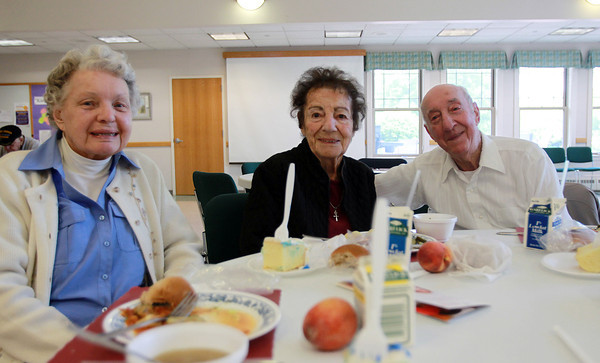 Danvers: From left, Roz Masse, Nanne Savoie, and Maurice Pelletier, at the Danvers Council on Aging's June Birthday Lunch on Wednesday afternoon. David Le/Salem News