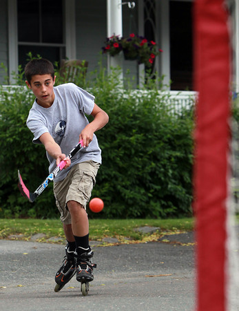 Beverly: Fourteen-year-old Charlier Lawler, of Beverly, takes a shot on net while playing street hockey on Monday afternoon. David Le/Salem News