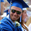 Danvers: Danvers High School graduate Joe Strangie smiles while talking with classmate Kyle Sullivan during graduation on Saturday afternoon. David Le/Salem News