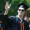Beverly: Beverly High School graduate Zach Hall waves to his family as he marches into Graduation on Sunday afternoon. David Le/Salem News
