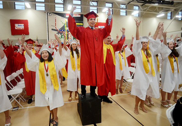 Graduating Class President Michael Dillon, center, leads the class in an impromptu song during commencement ceremonies Friday evening at Masconomet Regional High School in Topsfield. (Photo by Mike Springer)