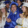 Beverly:<br /> Graduates from left, Mariah Baer of Beverly, Kane Avery of Ipswich, and Katy Aldrich of Nahant applaud for the receiptiants of the academic awards during the Landmark School graduation.<br /> Photo by Ken Yuszkus/Salem News, Friday, June 7, 2013.