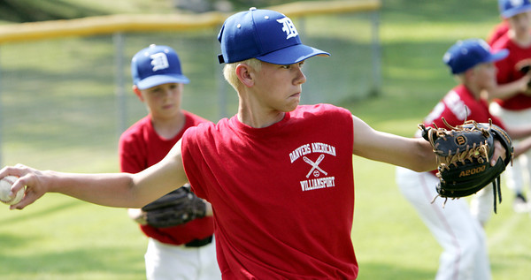 Danvers:<br /> Thomas Mento at the Danvers American Little League practice at Memorial Field.<br /> Photo by Ken Yuszkus / Salem News, Monday, June 24, 2013.