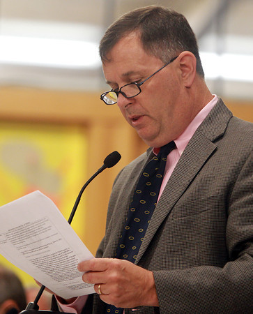 Hamilton: Hamilton Selectman Mark Johnson makes a motion to purchase the Pirie Property. Hundreds of people crammed into the cafeteria and gymnasium at the Winthrop School for a special town meeting to address the controversial proposal to buy Pirie Property. David Le/Salem News
