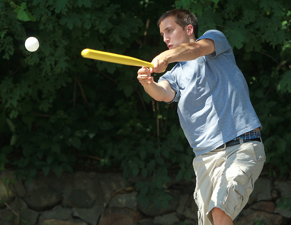 Swampscott: Ned Lockwood, of Swampscott, plays whiffle ball with his friend Sam Stratton at the end of their street on Monday afternoon. David Le/Salem News