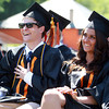 Beverly: Beverly High School graduates Corey Malone and Berina Malicbegovic laugh during twin brothers Idan and Adi Davidyan's speech to the Class of 2013 at Graduation on Sunday afternoon. David Le/Salem News