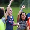 Beverly: North Beverly Elementary School 5th graders Hailey Anderson, left, and Danyca Santillian, right, jump up and cheer loudly after their classmates scored a point against the teachers in the 5th graders vs faculty volleyball game on Field Day on Thursday. David Le/Salem News