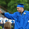 Danvers: Danvers High School graduate Justin Woodbury gets a high five from a DHS faculty member after receiving his diploma on Saturday afternoon. David Le/Salem News