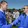 Graduates Peter Hale, left, and Jake Powell congratulate each other following Swampscott High School's 2013 graduation ceremonies at the Blocksidge Field House in Swampscott. (Photo by Mike Springer)
