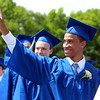 Danvers: Danvers High School graduate Kyle Butler waves to his family in the crowd while marching into graduation on Saturday afternoon. David Le/Salem News