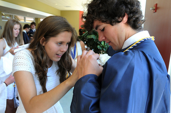 Wenham:<br /> Hamilton-Wenham grads Darby Mackintosh, left, pins a carnation on Tyler Mulley while getting ready for the Hamilton-Wenham graduation held at the Gordon College chapel on Sunday at noon.<br /> Photo by Ken Yuszkus, Salem News, Sunday June 2, 2013.