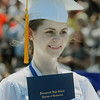 Graduating senior Shannon McGovern shows her new diploma Sunday during Swampscott High School's 2013 graduation ceremonies at the Blocksidge Field House in Swampscott. (Photo by Mike Springer)