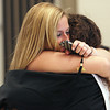 Ipswich:<br /> Ipswich grads Brittany Potter, left, and Courtney Long hug as the seniors assemble prior to the processional for the Ipswich graduation on Sunday.<br /> Photo by Ken Yuszkus, Salem News, Sunday June 2, 2013.