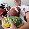 Middleton:<br /> Masconomet football player Casey Guerrero will be playing in this week's 52nd annual Agganis All-Star Football Game. He is holding a rugby ball, football, and football helmet.<br /> Photo by Ken Yuszkus / Salem News, Tuesday, June 25, 2013.
