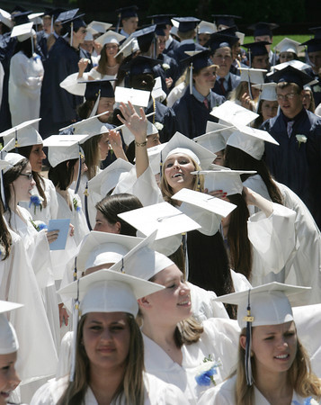 Wenham:<br /> Hamilton-Wenham grads pause during the processional into Gordon College chapel at the Hamilton-Wenham graduation on Sunday at noon.<br /> Photo by Ken Yuszkus, Salem News, Sunday June 2, 2013.