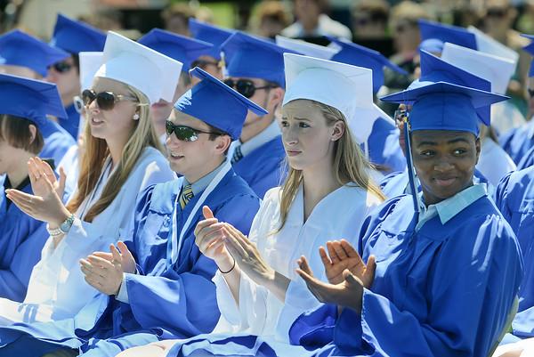 Graduating seniors applaud a speaker Sunday during Swampscott High School's 2013 graduation ceremonies at the Blocksidge Field House in Swampscott. (Photo by Mike Springer)