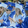 Graduating seniors applaud a speaker Sunday during Swampscott High School's 2013 graduation ceremonies at the Blocksidge Field House in Swampscott. (Photo by Mike Springer)