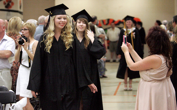 Ipswich:<br /> Ipswich grad Michaela Wintersteen has her photo taken by her mother Victoria during the processional for the Ipswich graduation on Sunday.<br /> Photo by Ken Yuszkus, Salem News, Sunday June 2, 2013.