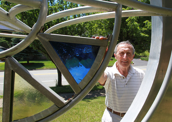 Danvers: Michael Guadagno, owner of the Barn Workshop Gallery, stands with one of his sculptures. The Gallery will be having its 40th Anniversary Sculpture Show. David Le/Salem News