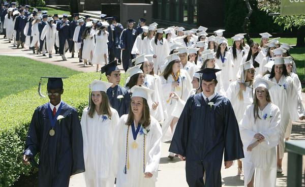 Wenham:<br /> Hamilton-Wenham grads walk during the processional into Gordon College chapel at the Hamilton-Wenham graduation on Sunday at noon.<br /> Photo by Ken Yuszkus, Salem News, Sunday June 2, 2013.