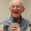 Danvers: Jack Perry, of Peabody, laughs while playing bridge at the Danvers Senior Center on Friday afternoon. David Le/Salem News