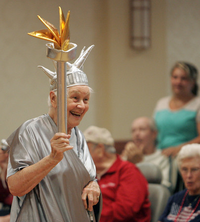 Peabody:<br /> Ursala Bade is dressed as the Statue of Liberty during the Brooksby Village 4th of July parade held indoors at the McIntosh Clubhouse.<br /> Photo by Ken Yuszkus / Salem News, Friday, June 28, 2013.