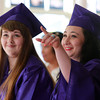 Beverly: Northshore Recovery High School graduates Olivia Pierce, right, and Kelsy Thompson, smile at the start of their Graduation on Wednesday evening. David Le/Salem News