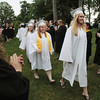 Danvers:<br /> Secretary Kellie Fone of Methuen, right, is first, next is treasurer Brianna Mann of Stoneham, followed by the other class officers and graduates which march past the applauding faculty into the tent during the processional for the Essex Agricultural and Technical High School graduation.<br /> Photo by Ken Yuszkus / Salem News, Thursday, June 6, 2013.