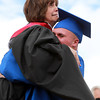 Danvers: Danvers High School Principal Susan Ambrozavitch reacts in shock after graduating senior Connor Morrison picked her up in a big hug after receiving his diploma on Saturday afternoon. David Le/Salem News