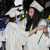 Beverly:<br /> Maxye Cataldo of West Roxbury, left, and Maria Tashjian of Wellsley, hug as Maria passes by the seated graduates during the processional at the Landmark School graduation.<br /> Photo by Ken Yuszkus/Salem News, Friday, June 7, 2013.