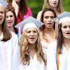 "Danvers: Danvers High School graduates, Ashley Brooks, Emily Murphy, and Erin Lovett, sing ""It's Time"" with the DHS Chamber Singers on Saturday afternoon. David Le/Salem News"