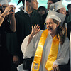 Danvers:<br /> Graduate Erin Harney of Lynn waves enthusiastically at her seat while her fellow graduates file in during the processional of the Essex Agricultural and Technical High School graduation.<br /> Photo by Ken Yuszkus / Salem News, Thursday, June 6, 2013.