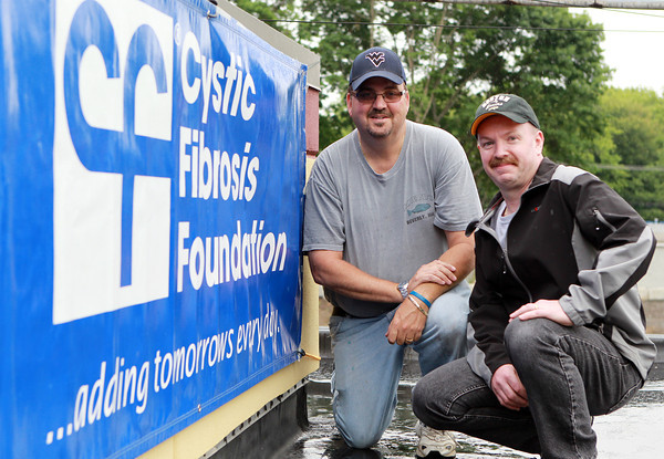 Danvers: Brian Harrison, left, and Keith Burgess, right, are taking part in the 13th Annual Roof Top Retreat in hopes of raising $20,000 for the Cystic Fibrosis Foundation, on top of McKinnon's Market on Holten St. in Danvers. David Le/Salem News