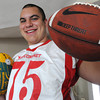 Middleton:<br /> Masconomet football player Casey Guerrero will be playing in this week's 52nd annual Agganis All-Star Football Game. He is holding a rugby ball and football.<br /> Photo by Ken Yuszkus / Salem News, Tuesday, June 25, 2013.