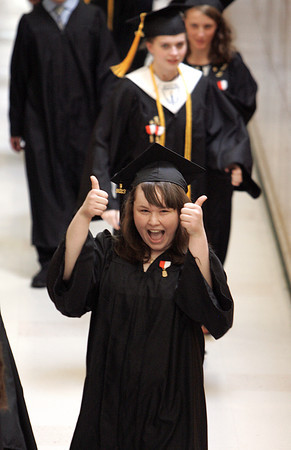 Ipswich:<br /> Ipswich grad Kimberly Rideout gives the thumbs up as she is about to enter the gym during the processional for the Ipswich graduation on Sunday.<br /> Photo by Ken Yuszkus, Salem News, Sunday June 2, 2013.