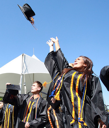 Beverly: Beverly High School senior class Vice President Natalie Shea leads her fellow graduates in the tossing of their mortar boards at the conclusion of Graduation on Sunday afternoon. David Le/Salem News